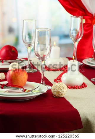 beautiful holiday table setting with apples, close up