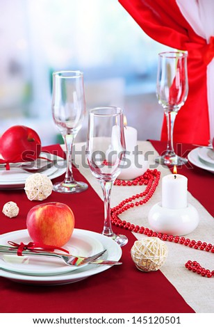 beautiful holiday table setting with apples, close up - stock photo