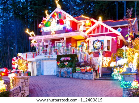 Beautiful home decorated and lighted for Christmas and for New Year Eve at Night at Vancouver, Canada. - stock photo