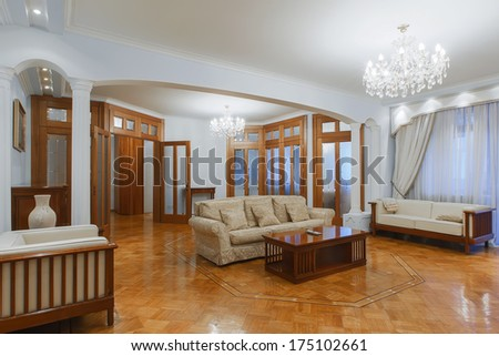 Beautiful home entrance with wood floor. New luxury interior of livingroom  - stock photo