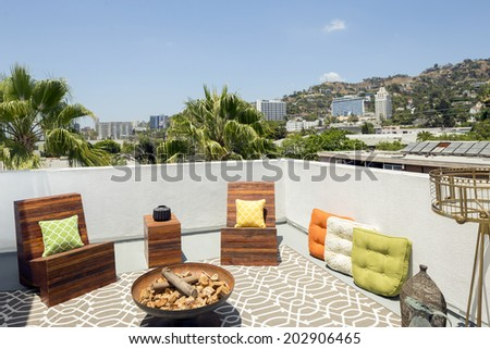 Beautiful Home Exterior Patio / rooftop with pillows at daytime - stock photo