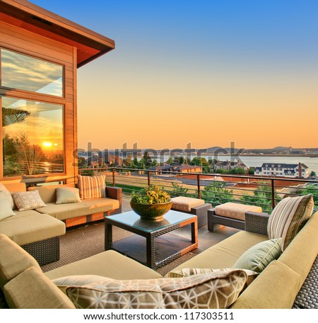 Beautiful Home Exterior Patio with Sunset View - stock photo