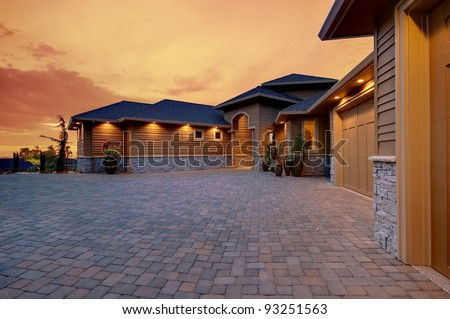 Beautiful Home Exterior with Sunset Glow - stock photo
