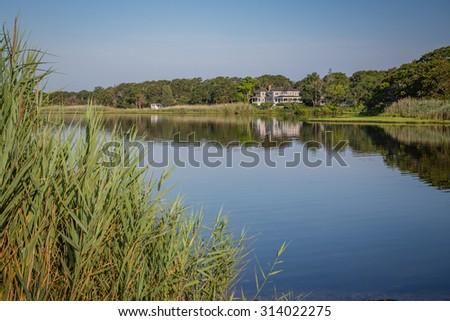 Beautiful home reflects in pond near Oak Bluffs in Martha's Vineyard - stock photo