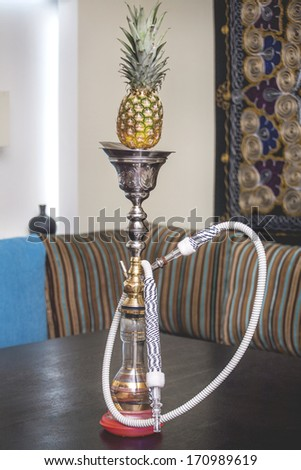 beautiful hookah with pineapple is on the table - stock photo