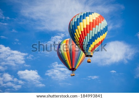 Beautiful Hot Air Balloons Against a Deep Blue Sky and Clouds. - stock photo