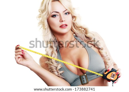 beautiful hot blond woman with measure tape in her hands - stock photo