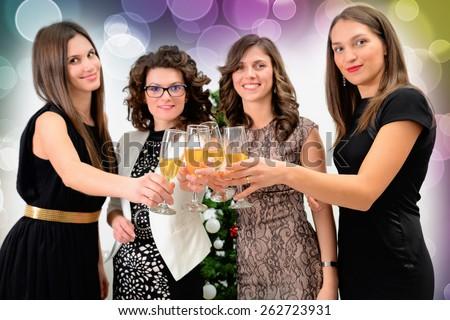 Beautiful hot girls having party fun, drinking champagne. - stock photo