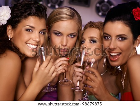 Beautiful hot girls having party fun, drinking champagne. - stock photo