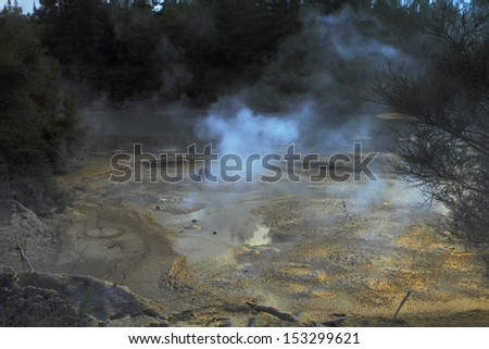 Beautiful hot mud boiling in the geyser field in Rotorua, New Zealand - stock photo