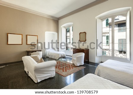 beautiful hotel room in a historic building, double room - stock photo