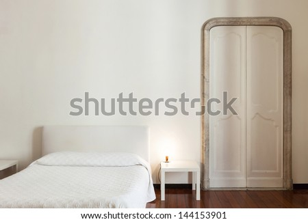 beautiful hotel room in old building, double room - stock photo