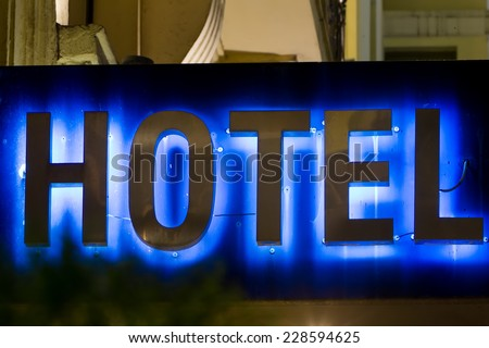 Beautiful hotel sign in Greece. Neon Sign with the word Hotel - stock photo