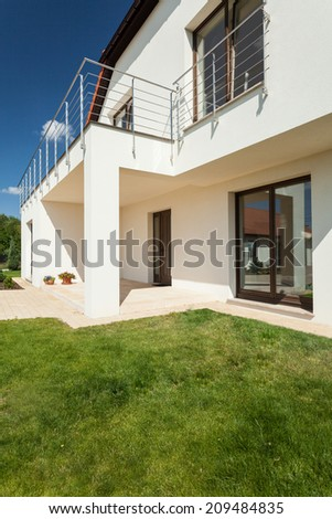 Beautiful house during sunny day from the outside - stock photo