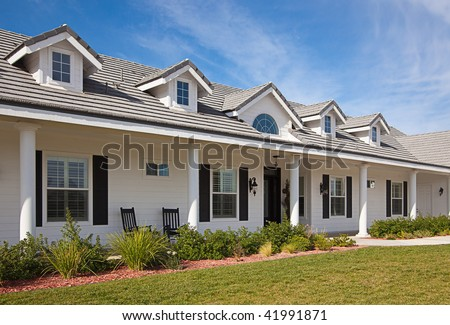Beautiful House Facade Against a Blue Sky - stock photo