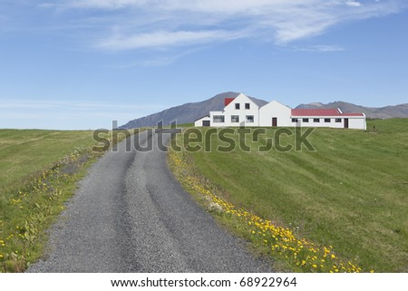 Beautiful house green and blue, summer picture from iceland - stock photo