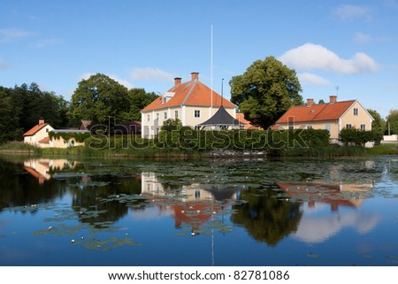 Beautiful  house  in Sweden with reflections in the river.