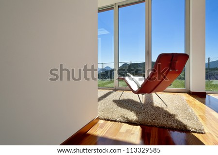 beautiful house, modern style, room view with a chair - stock photo
