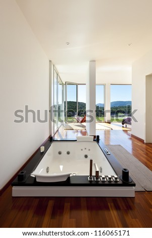 beautiful house, modern style, room with jacuzzi - stock photo