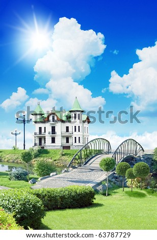 beautiful house, on a grassland under sky with clouds - stock photo