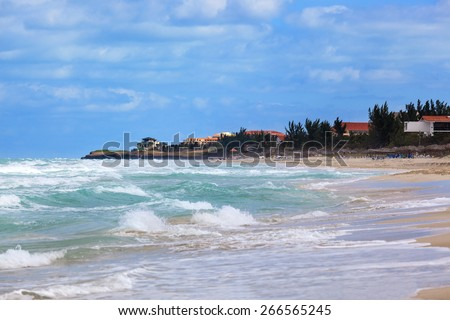 beautiful house on the beach on a sunny day - stock photo