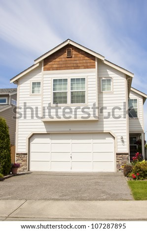 beautiful house with blue sky and lush landscape - stock photo