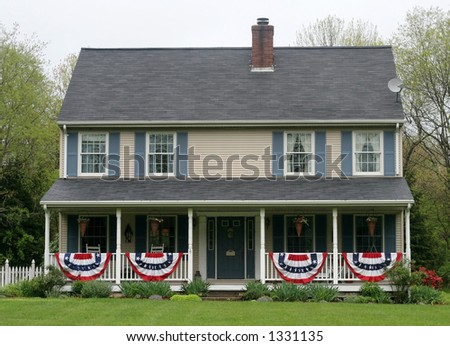 beautiful house with patriotic flags - stock photo