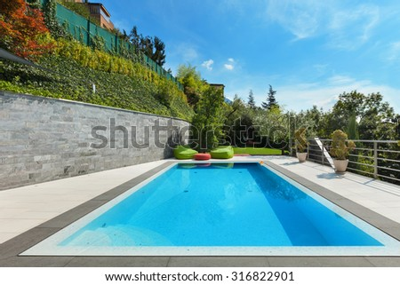 beautiful  house with swimming pool, summer day - stock photo