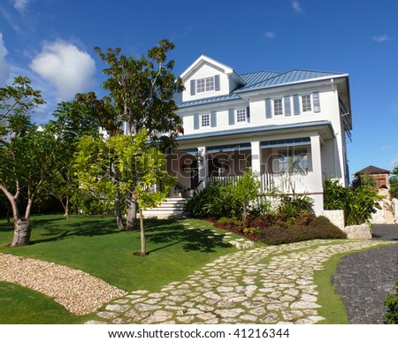 Beautiful house with the garden and drive way - stock photo