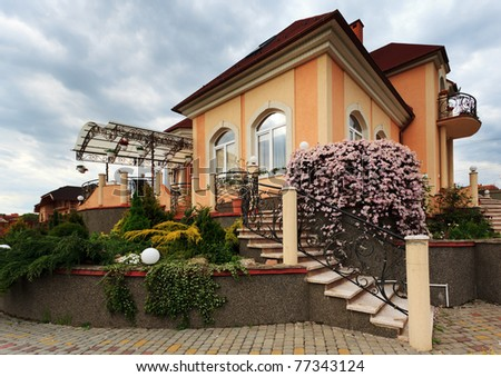 Beautiful house yard with different plants - stock photo