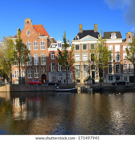 Beautiful houses at canals in Amsterdam. Netherlands - stock photo