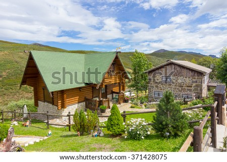beautiful houses in high mountains during the summer - stock photo