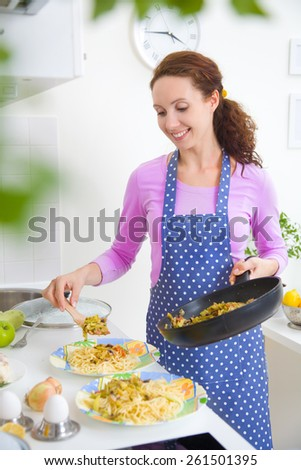 beautiful housewife cooked dinner in the kitchen
