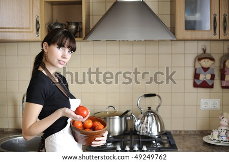 Beautiful housewife cooking - stock photo