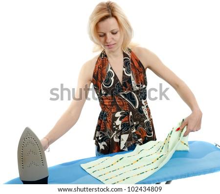 Beautiful housewife ironing the laundry on white background - stock photo