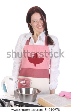 beautiful housewife preparing with a book recipe - stock photo
