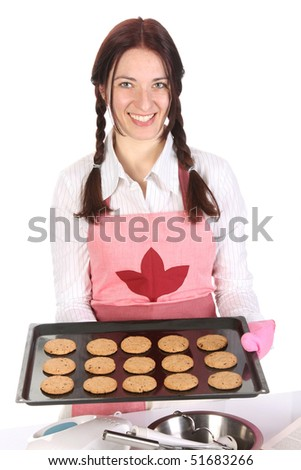 beautiful housewife showing off cakes on white background - stock photo