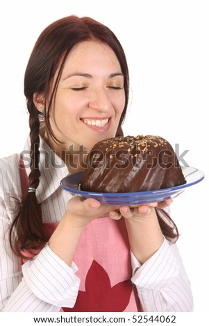 beautiful housewife smelling bundt cake on white background - stock photo