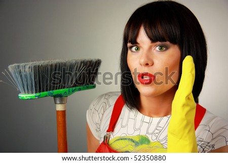 Beautiful Housewife with Broom