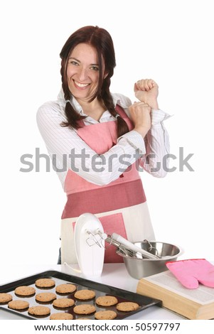 beautiful housewife with completed cakes on white background - stock photo