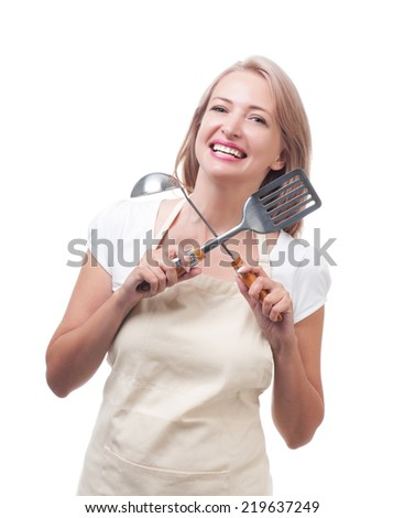 Beautiful housewife with ladle and spatula. Isolated on white background - stock photo