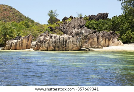 Beautiful Huge granite boulders on beach at Curieuse Island in Indian Ocean. - stock photo
