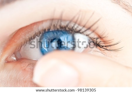 beautiful human eye and contact lens - stock photo