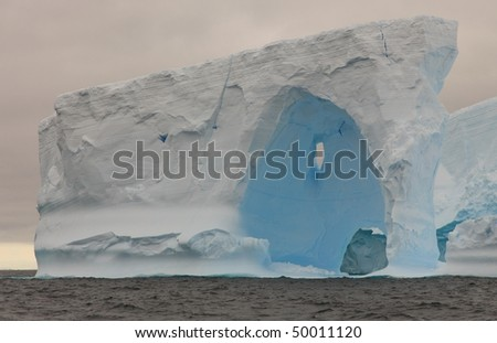 Beautiful iceberg in Antarctica seen from a sailing boat - stock photo