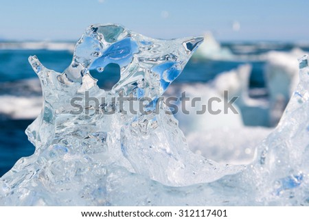 Beautiful Icelandic iceberg with a heart-shaped hole in it. - stock photo