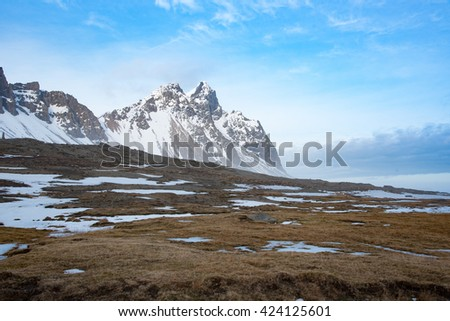 Beautiful iconic Vesturhorn mountain. Light fog under the mountain.