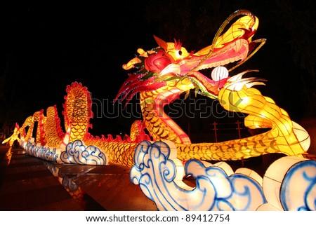 Beautiful illuminated Dragon Lantern in Chinese Happy new year Lantern Festival or Yee Peng Festival, Chiangmai Thailand - stock photo