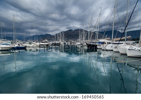 Beautiful illustration with yachts in the bay. Luxury boats and reflection in water. - stock photo