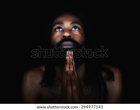 Beautiful Image of a Afro American man Praying - stock photo