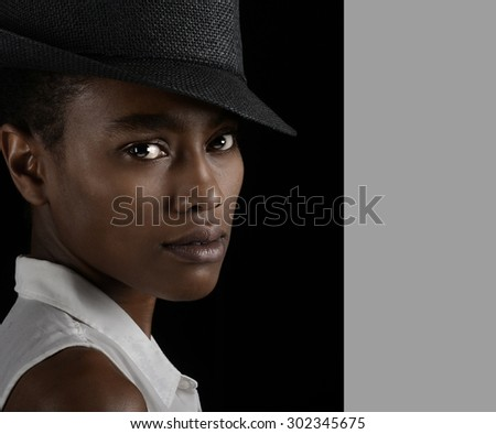Beautiful Image of a afro American Woman on Black  - stock photo